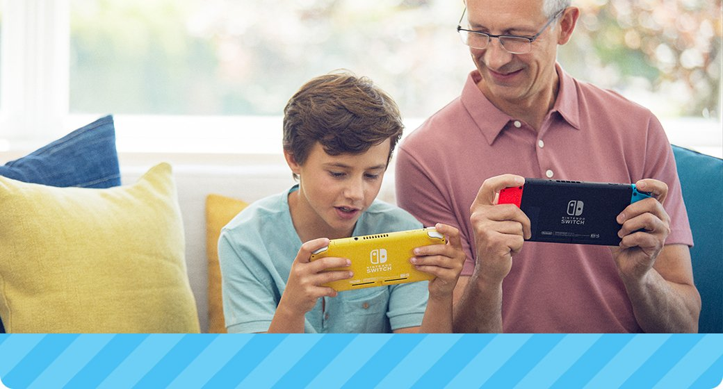 Picture of grandson and grandpa on a couch playing Nintendo Switch and Nintendo Switch Lite together.